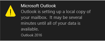 Outlook setting up a local copy of your mailbox popup.
